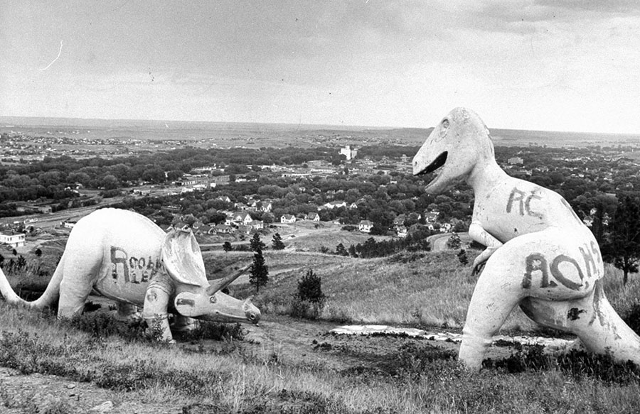 Concrete Sinclair Oil dinosaurs sit on a hill above Rapid City, South Dakota, in 1945. #  Hans Wild / The LIFE Picture Collection / Getty