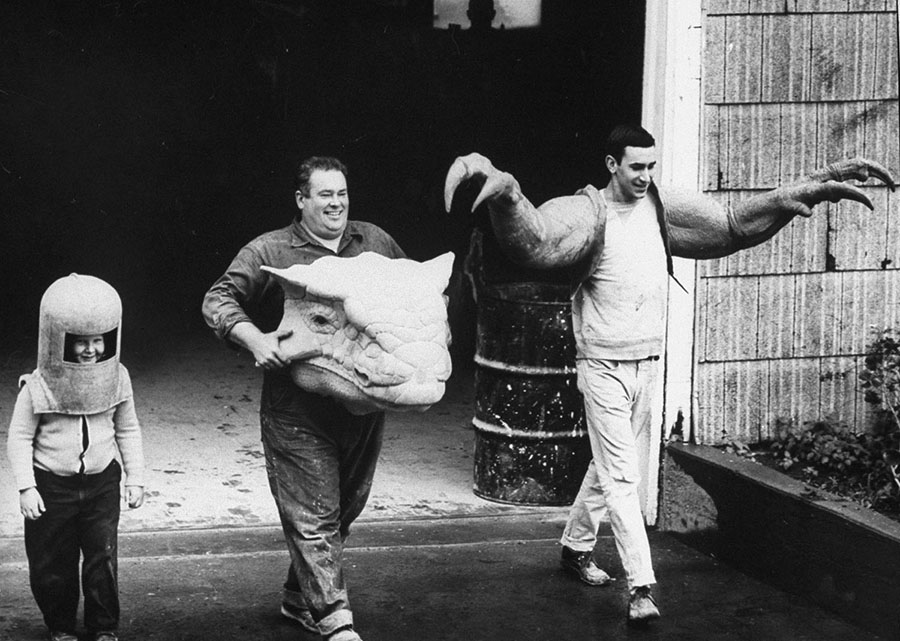 Workmen carry parts of dinosaur models designed by Louis Paul Jonas for the New York World's Fair in 1963. #  Arthur Schatz / The LIFE Images Collection / Getty