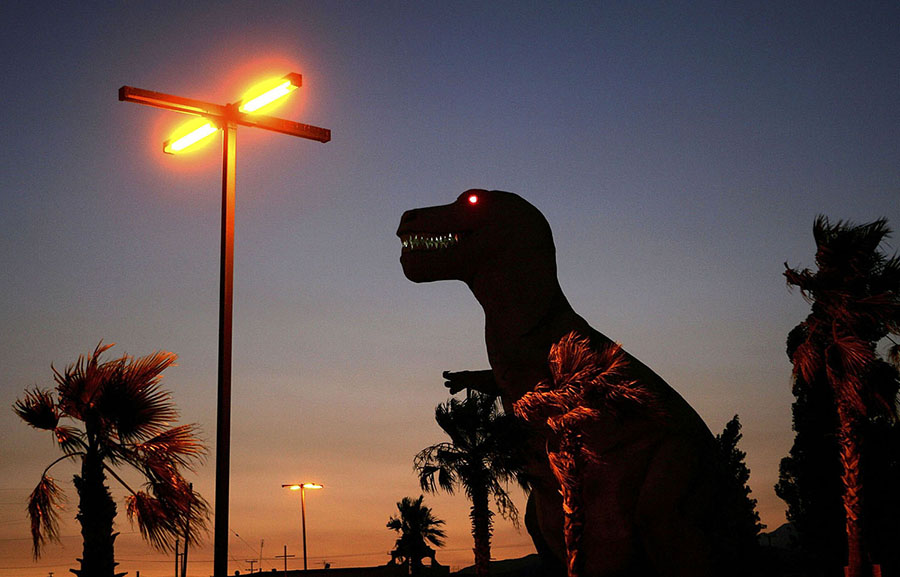 A red-eyed dinosaur towers over the desert near the San Andreas Fault on July 1, 2006, in Cabazon, California. #  David McNew / Getty