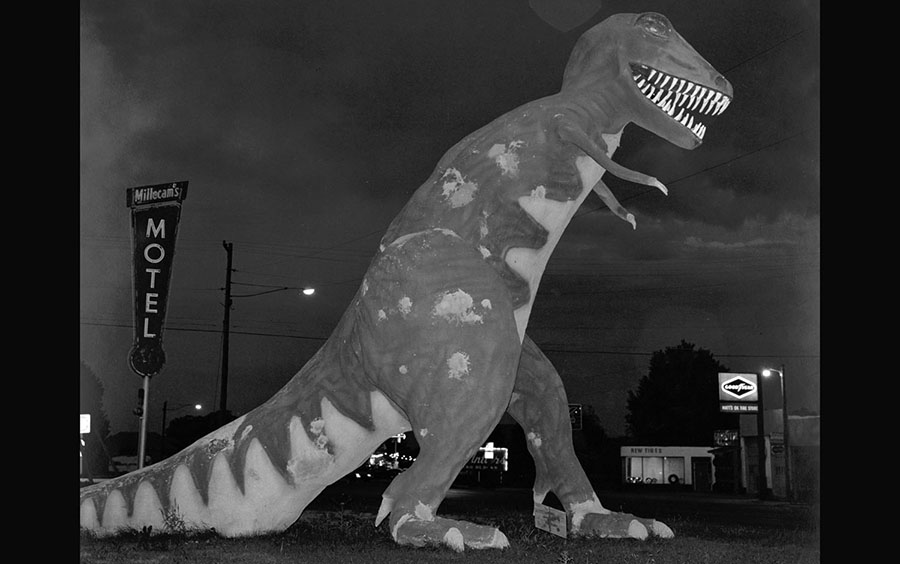 A dinosaur stands along Highway 40 in Utah, photographed in 1974 #  Steve Fitch / Library of Congress