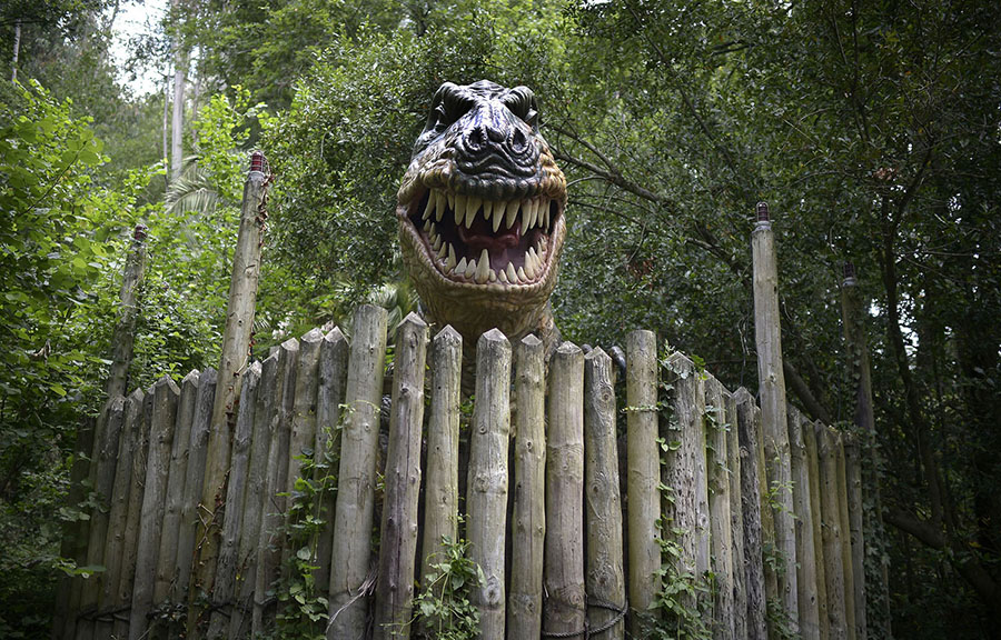 A large model inspired by a Tyrannosaurus rex bares its teeth at the Karpin Abentura park in the Karrantza valley, Spain, on July 26, 2014. #  Vincent West / Reuters