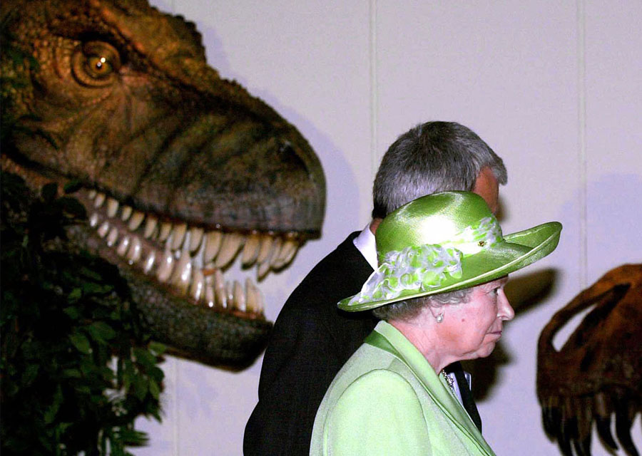 Britain's Queen Elizabeth II appears to be watched as she visits a dinosaur exhibition at the Yorkshire Museum in York, England, on July 27, 2000. #  John Giles / AP