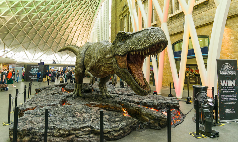 A 'dinosaur' promotes the 2015 film Jurassic World, at the Kings Cross station concourse, London. Fiction has fired the imagination, leading to a new wave of research.  Photograph: RZUK Images/Alamy Stock Photo