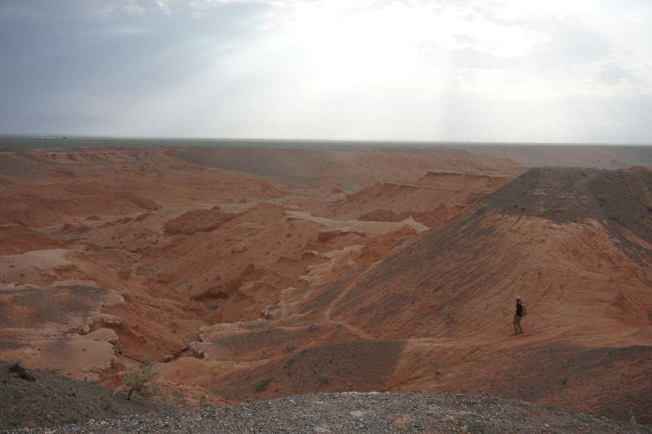 A Mongolian researcher leads the group down the Flaming Cliffs, the same region where Roy Chapman Andrews first found a nest of dinosaur eggs. KESHIA NAURANA BADALGE