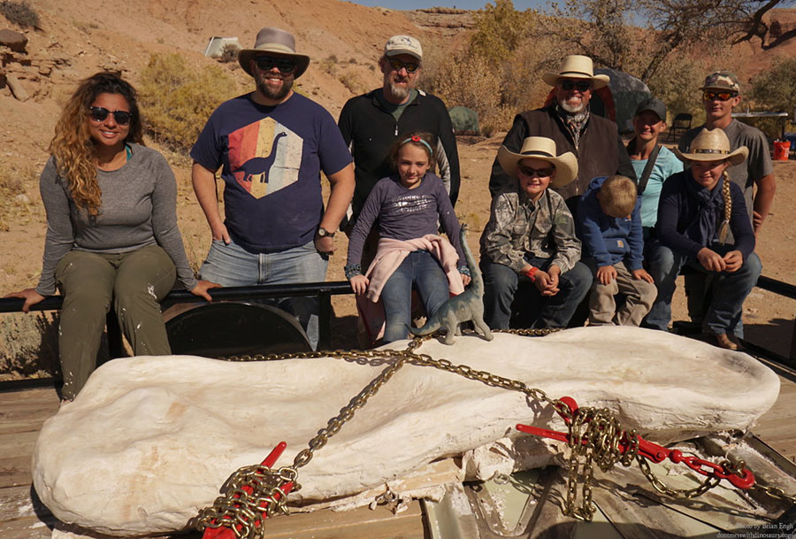 The paleontology team poses with the plaster-jacketed Brachiosaurus bone, Southern Utah, October 2019 | Photo by Brian Engh, courtesy of Utah State Parks, St. George News