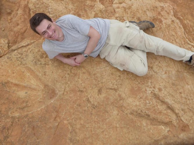 Dr Fabien Knoll from the University of Manchester poses with the footprints in South Africa University of Manchester