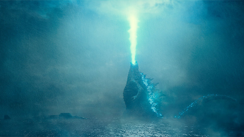 "Godzilla rises from the depths and unleashes his atomic breath to claim his crown in the 2019 release, ""Godzilla: King of the Monsters."" COURTESY OF WARNER BROS."