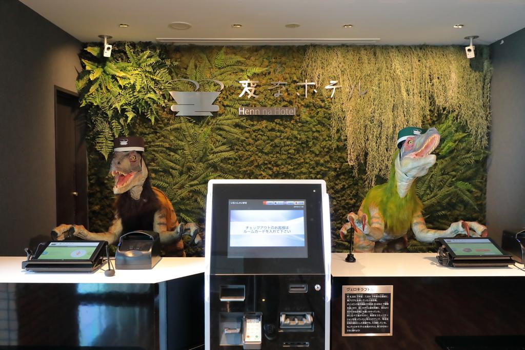 These robot dinosaurs, seen at the front desk at the Henn na Hotel in Urayasuon on Friday, can also 'speak' four languages: Japanese, English, Chinese and Korean.