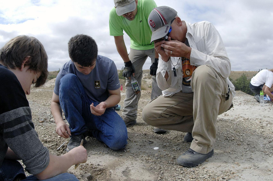 High school students help at a fossil dig site overseen by the North Dakota Geological Survey near Medora, N.D. The North Dakota Geological Survey is expanding its well-received fossil dig program in 2019.  MIKE MCCLEARY, The Bismarck Tribune via AP