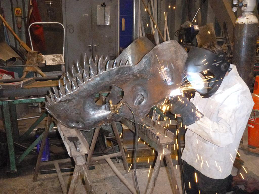 Jaw-dropping: William works on the allosaurus's head