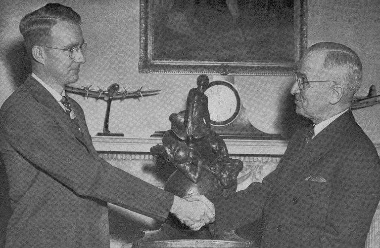 Luis Alvarez (left) accepting an award from president Harry S Truman (Wikimedia Commons).