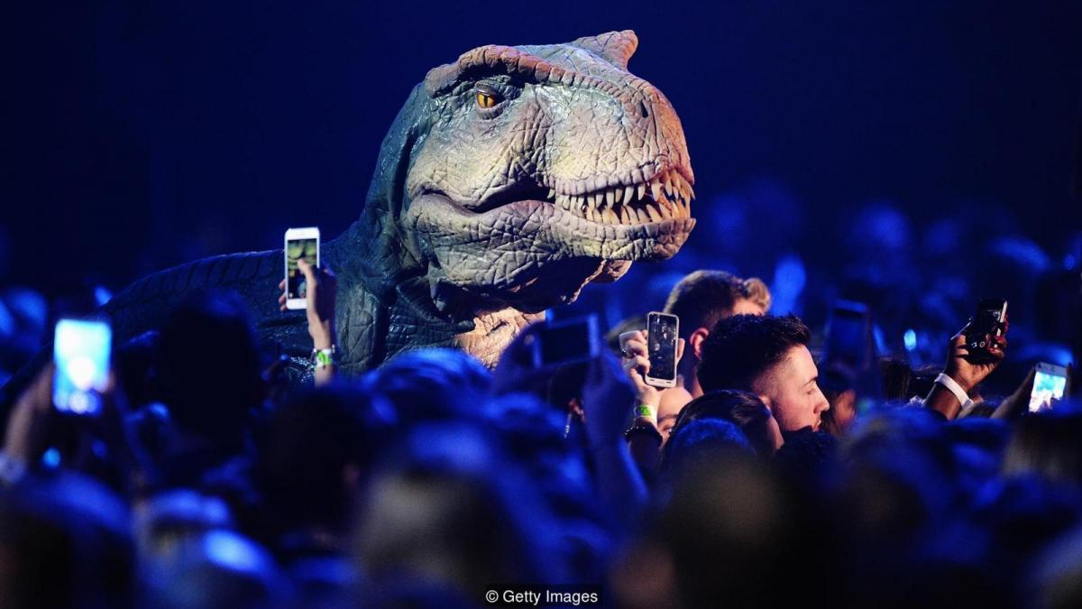 Model dinosaur surrounded by people (Credit: Getty Images)
