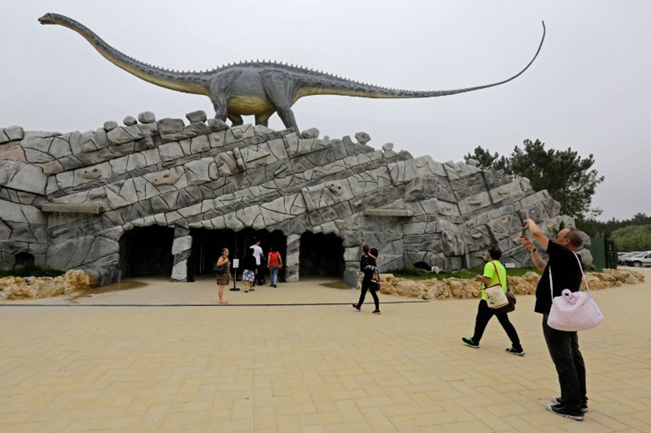 People visit the Dino Park, an outdoor museum with more than 120 models of dinosaurs, in Lourinha. Jose Manuel Ribeiro, AFP