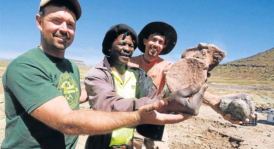 Shepherd Dumangwe Tyhobela (center) of Sterkspruit is being credited with the exciting discovery of a massive dinosaur graveyard in the Eastern Cape.