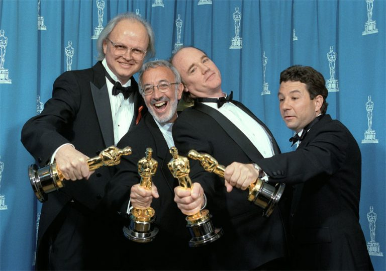 Stan Winston, Phil Tippett and Michael Lantieri pose with their Academy Awards they won for Visual Effects