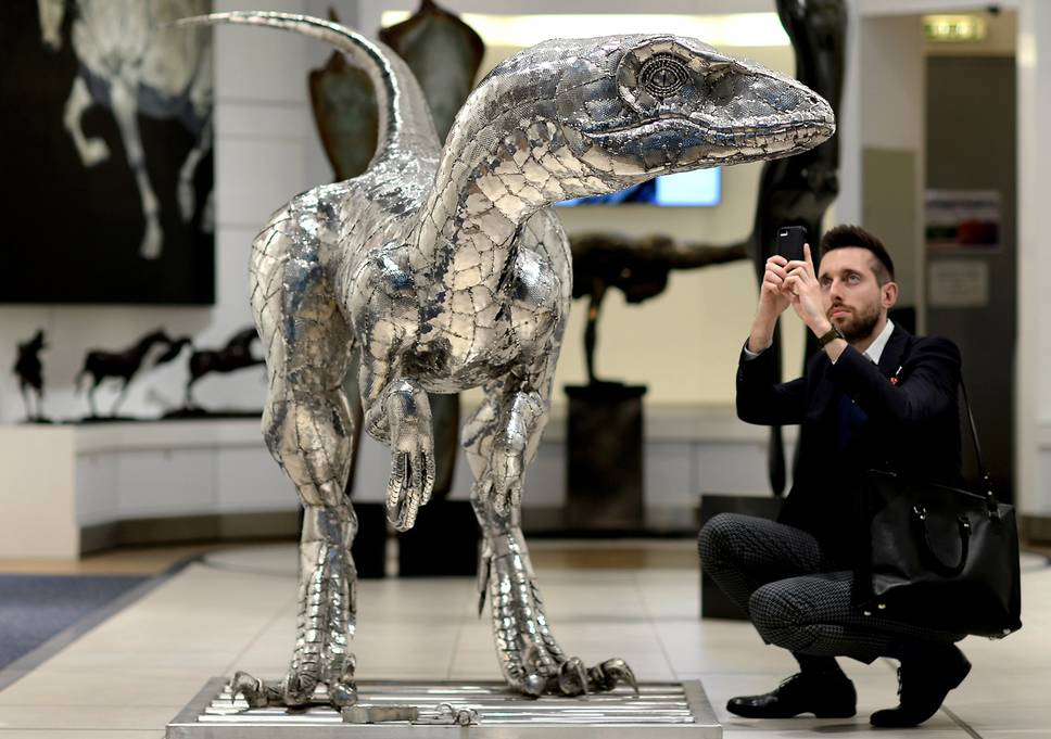 Prehistoric crowd-pleaser: The Velociraptor sculpture on display at T5 Gallery London Heathrow David Dyson