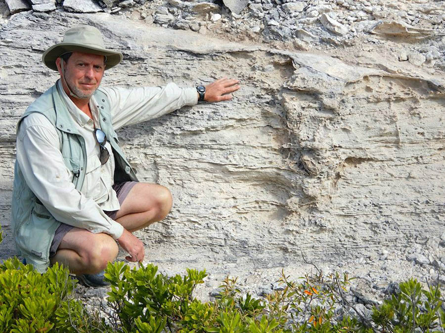 Professor Martin next to the Pleistocene iguana burrow. Image credit: Melissa Hage.